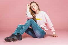 Teenager girl over pink stock images