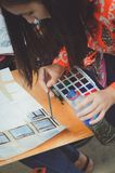 A teenager girl paints a picture with watercolors. stock image