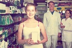 Teenager girl in pharmacy Stock Images