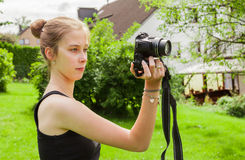 Teenager girl while photographing Stock Image