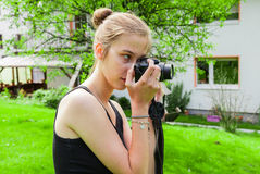 Teenager girl while photographing Royalty Free Stock Image