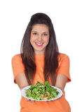 Teenager girl with a plate of vegetables Stock Image