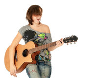 Teenager girl playing an acoustic guitar Royalty Free Stock Images