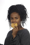 Teenager girl playing with a donut Stock Image