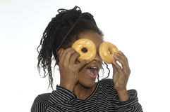 Teenager girl playing with a donut Stock Photography
