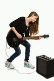 Teenager girl playing guitar. Against white background Royalty Free Stock Image