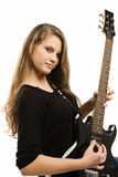 Teenager girl playing guitar Stock Images