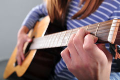 Teenager girl playing guitar Royalty Free Stock Photo