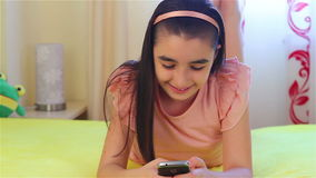 Teenager girl playing on smart phone stock footage
