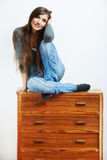 Teenager girl portrait at home. Young smiling woman with clothes Royalty Free Stock Image