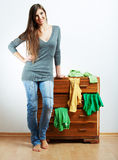 Teenager girl portrait at home. Young smiling woman with clothes Stock Images