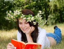 Teenager girl reading book Stock Photo