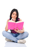 Teenager girl reading book Royalty Free Stock Photo