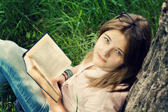 Teenager girl reading book Stock Photos