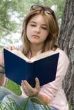 Teenager girl reading book Stock Photo