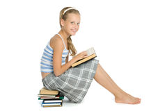 Teenager girl reading book. On floor isolated on white Royalty Free Stock Photography
