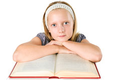 Teenager girl reading a book isolated on white Royalty Free Stock Photography