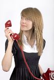 Teenager girl with red phone Royalty Free Stock Photo