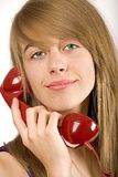 Teenager girl with red phone Royalty Free Stock Images