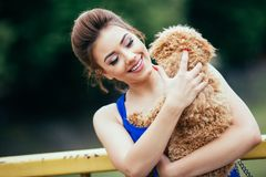 Teenager girl with red poodle royalty free stock image