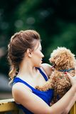 Teenager girl with red poodle stock images