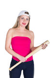 Teenager girl in a red top and baseball cap holding a baseball bat. isolated on white background Stock Photos