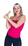 Teenager girl in a red top and baseball cap holding a baseball bat. isolated on white background Stock Images