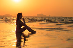Teenager girl relax on the beach in sunset. Teenager girl relaxing at the beach in sunset Royalty Free Stock Photography