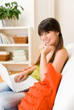Teenager girl relax home - happy with laptop Royalty Free Stock Images