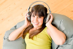 Teenager girl relax home - happy listen to music. Teenager girl relax home - happy with headphones listen to music Royalty Free Stock Images