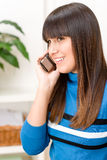 Teenager girl relax home - on phone Royalty Free Stock Photography