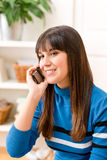 Teenager girl relax home - on phone Royalty Free Stock Photo