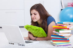 Teenager girl researching for a school project Stock Photo
