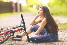 Free Teenager Girl Ride Bicycle On Country Road Through The Forest Stock Images - 175922174