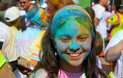 Teenager girl after run in a color powder competition Royalty Free Stock Photo