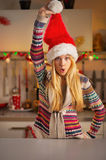 Teenager girl in santa hat having fun time Royalty Free Stock Image