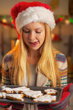 Teenager girl in santa hat with pan of cookies Stock Images