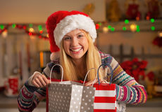 Teenager girl in santa hat with shopping bags Stock Image