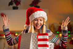 Teenager girl in santa hat with shopping bags Royalty Free Stock Photo