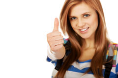 Teenager girl with school backpack and thumb up Royalty Free Stock Photography
