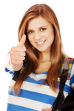 Teenager girl with school backpack and thumb up Stock Photo