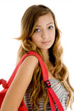 Teenager girl with school bag. Looking at camera stock image