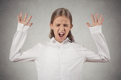 Teenager girl screaming, wide open mouth, hysterical. Portrait angry teenager girl screaming, wide open mouth, hysterical isolated grey wall background. Negative Royalty Free Stock Photography