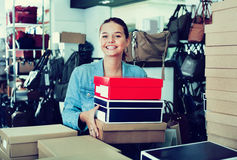Teenager girl shopping in store with bags Stock Photography