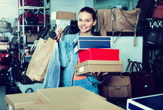 Teenager girl shopping in store with bags Royalty Free Stock Photography