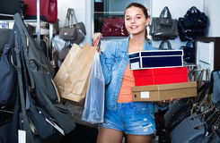 Teenager girl shopping in store with bags Royalty Free Stock Image