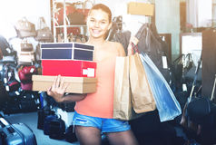 Teenager girl shopping in store with bags Royalty Free Stock Images