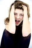 Teenager girl shouting isolated. Desoerate girl shouting feeling sadness and fear Royalty Free Stock Images