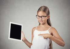 Teenager girl shows tablet with touchscreen display Royalty Free Stock Photo