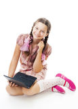Teenager girl sit holding small laptop. Teenager girl sit with small laptop and smile,isolated on white Stock Photos